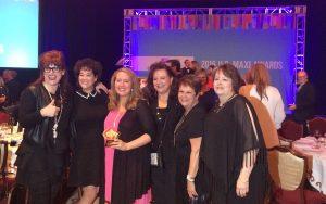 The Zona Rosa team celebrate their Maxi Gold Award win